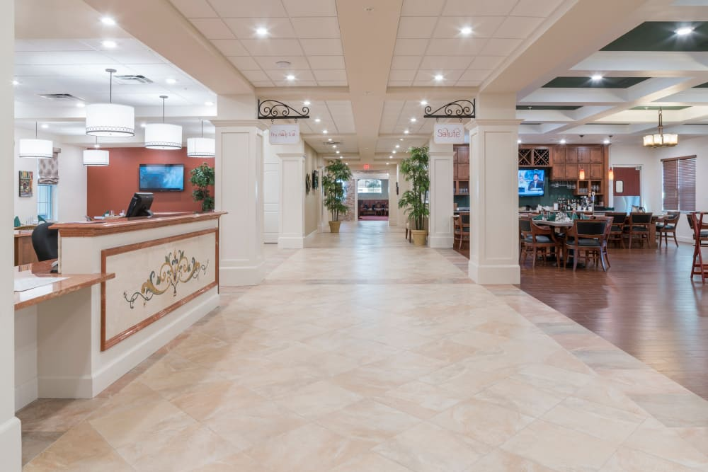 Front lobby and concierge at Merrill Gardens at ChampionsGate in ChampionsGate, Florida.