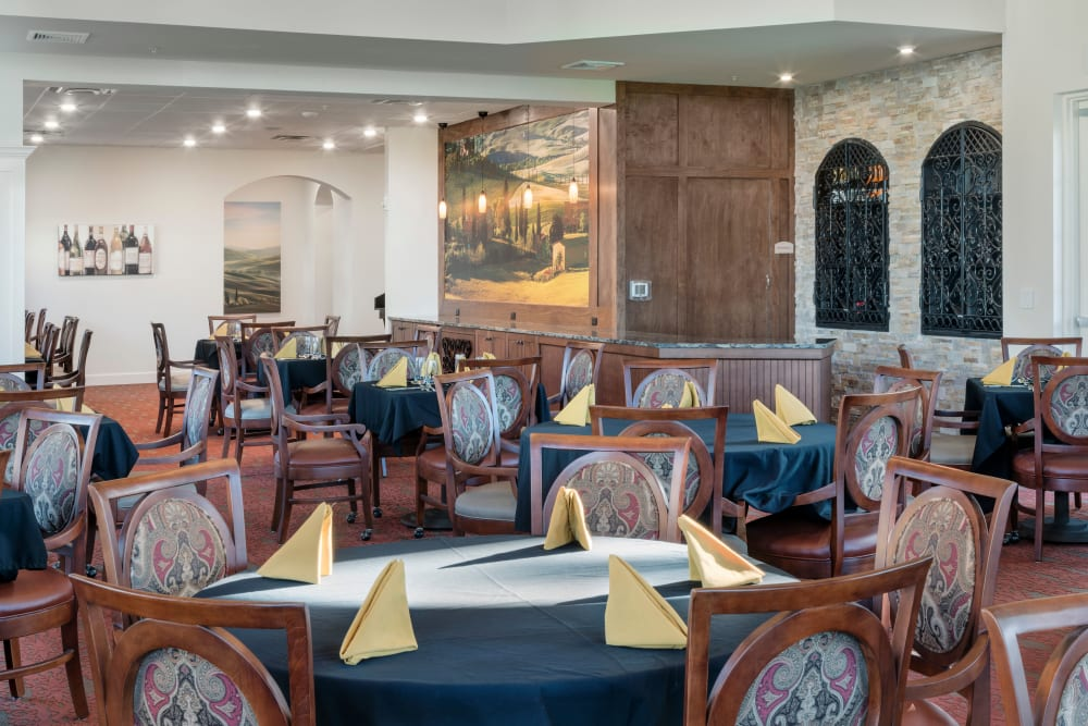 Community dining room at Merrill Gardens at ChampionsGate in ChampionsGate, Florida.