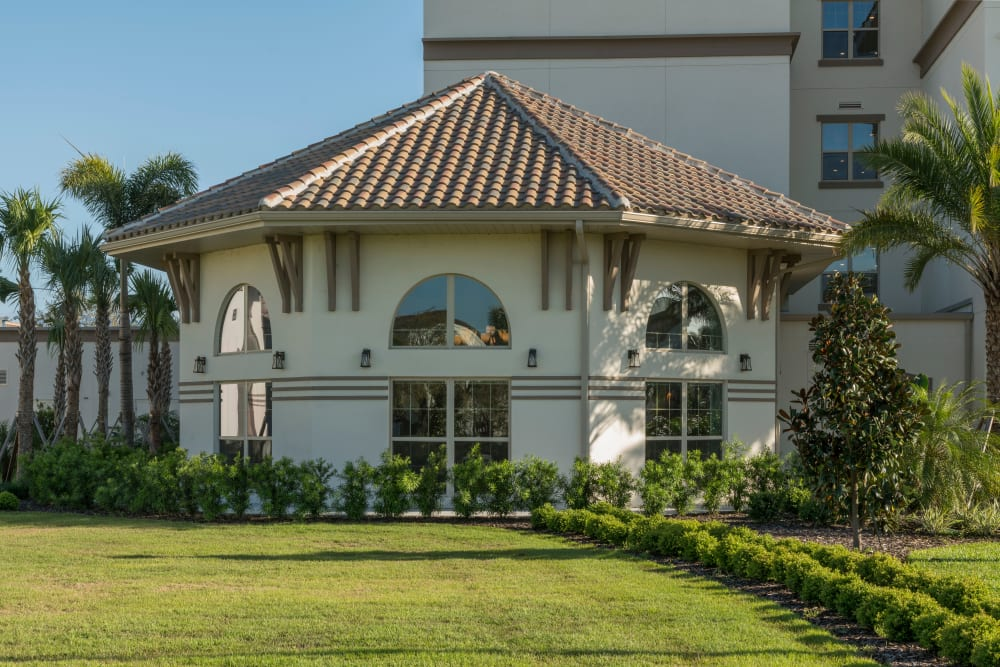 Exterior of sun room at Merrill Gardens at ChampionsGate in ChampionsGate, Florida.