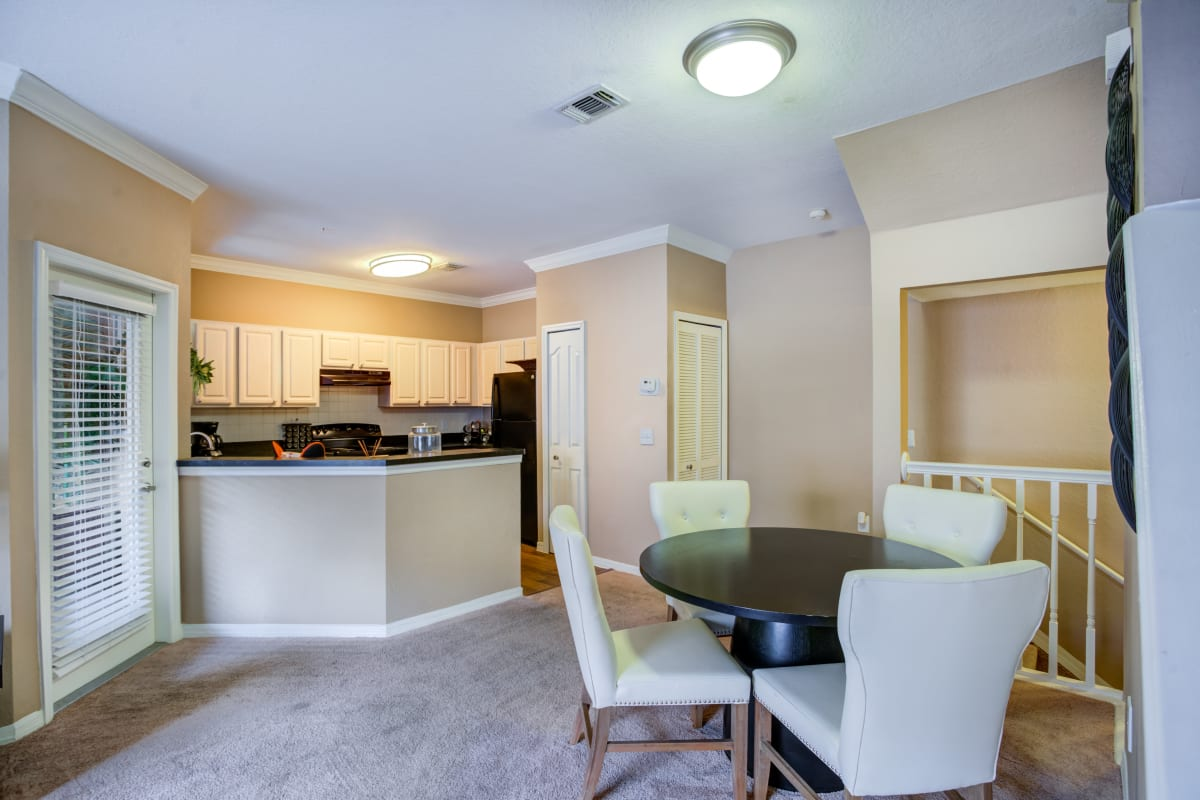 Spacious living room with plush carpeting at Amara at MetroWest in Orlando, Florida