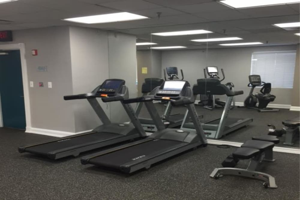 Fitness center with personal workout stations at Westwood Tower Apartments in Bethesda, Maryland
