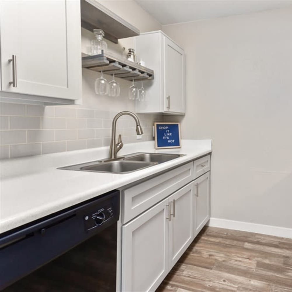 The kitchen with stainless-steel appliances at 1408 Casitas at Palm Valley in Avondale, Arizona