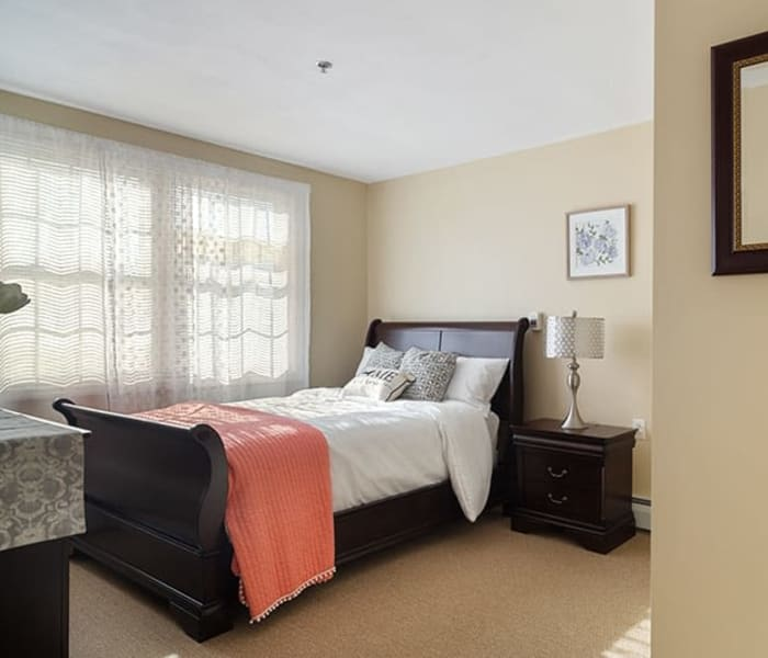 Bed in a 1 bedroom senior apartment at The Hearth on James in Syracuse, New York