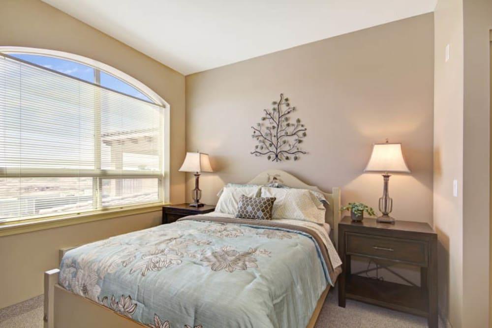 Bedroom at The Oaks, A Merrill Gardens Community in Gilbert, Arizona.