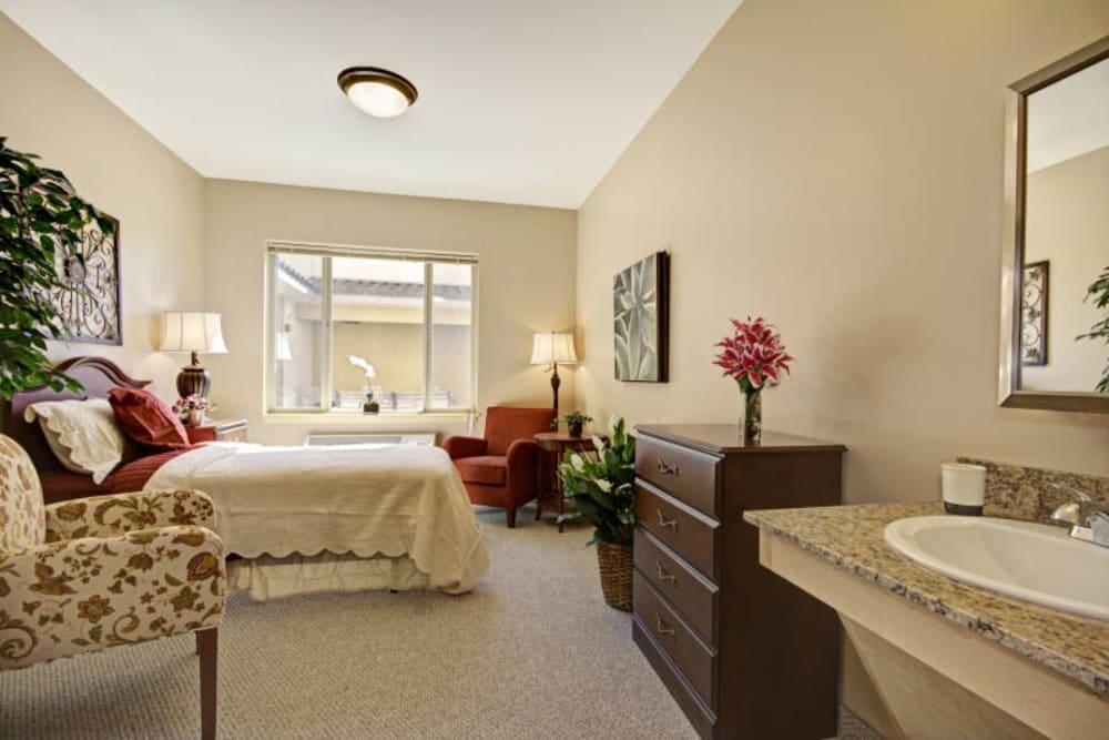 Spacious bedroom at The Oaks, A Merrill Gardens Community in Gilbert, Arizona