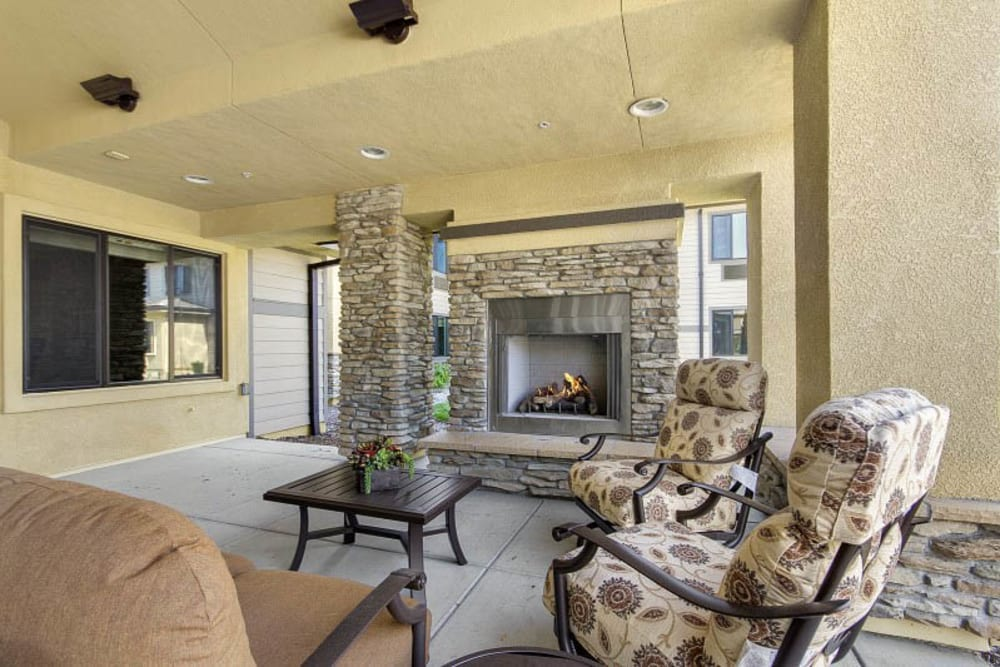 Lounge with fireplace at The Pines, A Merrill Gardens Community in Rocklin, California.