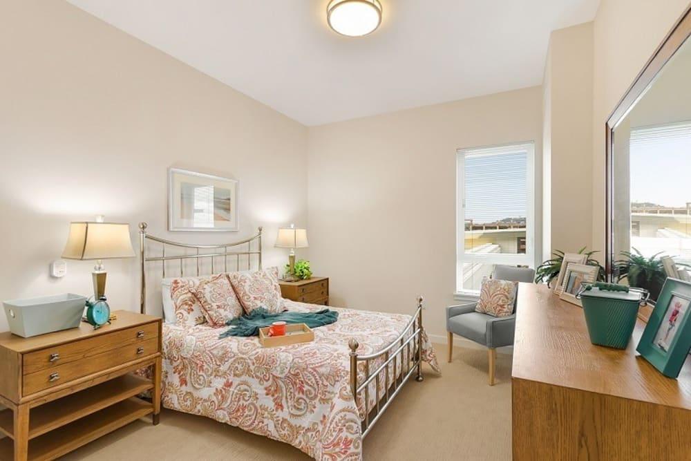 Model bedroom at Merrill Gardens at Auburn in Auburn, Washington.