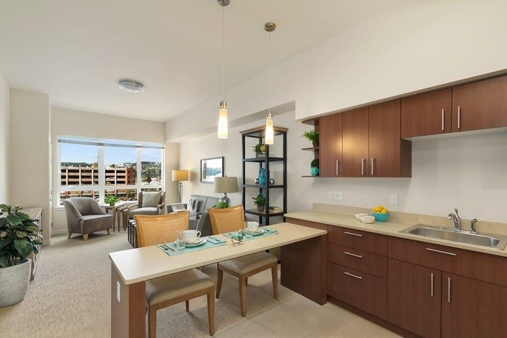 Apartment kitchen at Merrill Gardens at Auburn in Auburn, Washington.
