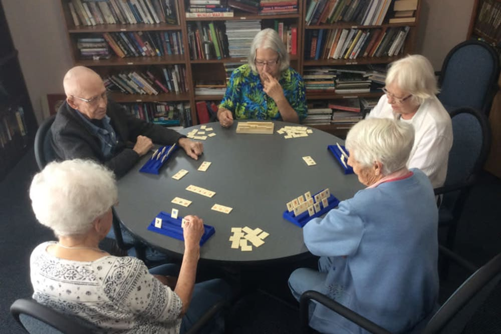 Resident friends playing a game at The Lakeside Village in Panora, Iowa.
