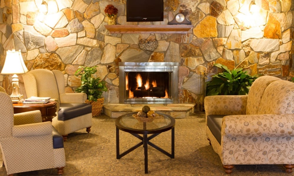 Lounge area with a fireplace at Royalton Woods in North Royalton, Ohio
