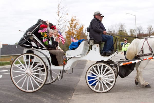 Two residents from Paloma Landing Retirement Community in Albuquerque, New Mexico in a horse drawn carriage