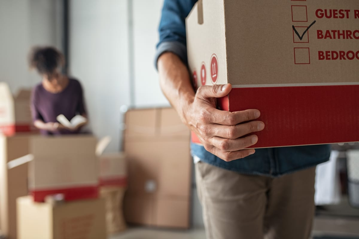 Man carrying boxed items for storage at Storage Units