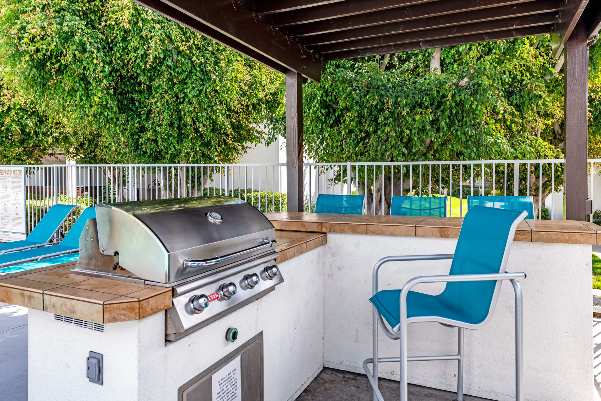 Poolside covered BBQ area at Kendallwood Apartments in Whittier, California