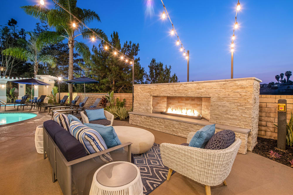 Outdoor community space with fireplace at Sofi Highlands in San Diego, California