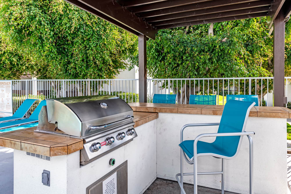 Grills by the pool at Kendallwood Apartments in Whittier, California