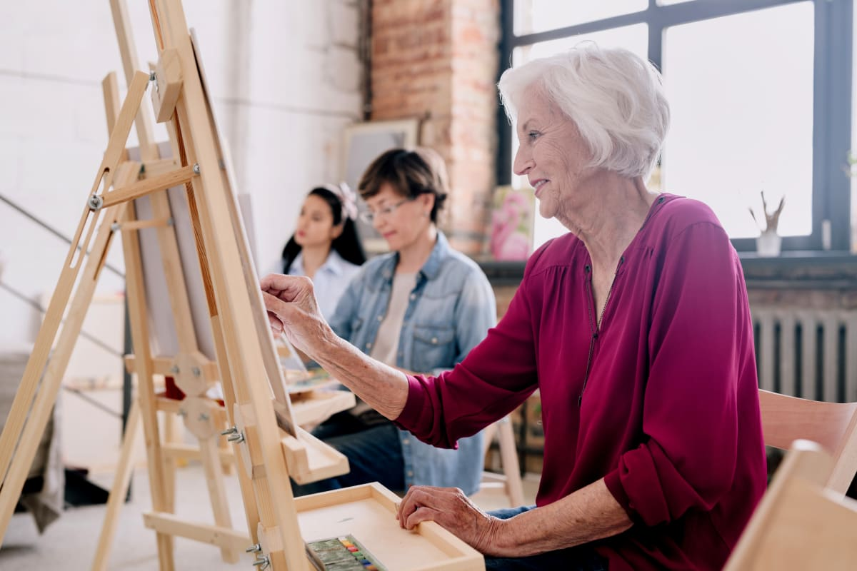 Residents painting in an art studio at Brentwood at LaPorte in La Porte, Indiana