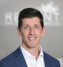 Kris Benson at Reliant Real Estate Management in Roswell, Georgia