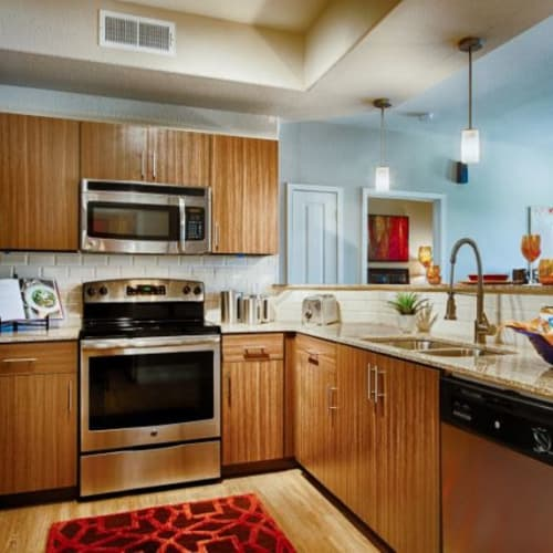 Stainless-steel appliances in a model home's kitchen at Elevation Chandler in Chandler, Arizona