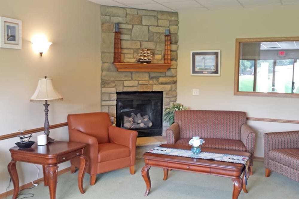 Resident sitting room with fireplace at Arbor View in Burlington, Wisconsin.