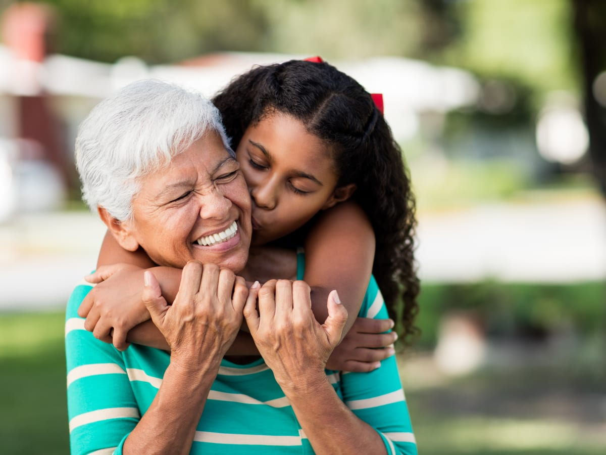 A resident being hugged by her young niece at Brightwater Senior Living in Bend, Oregon