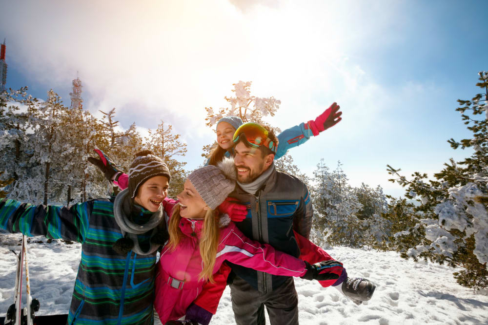 A happy family enjoying a ski weekend at Mt Hood, with gear they store at Trojan Storage