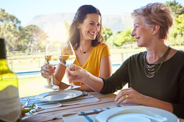 Women drinking wine near Avilla Centerra Crossings in Goodyear, Arizona