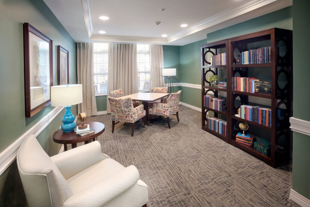 Reading corner with bookshelves at Brooklyn Pointe in Brooklyn, Ohio