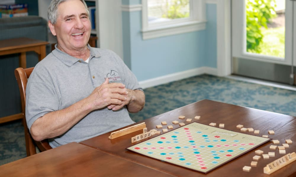 Residents playing Scrabble at Traditions of Lansdale in Lansdale, Pennsylvania