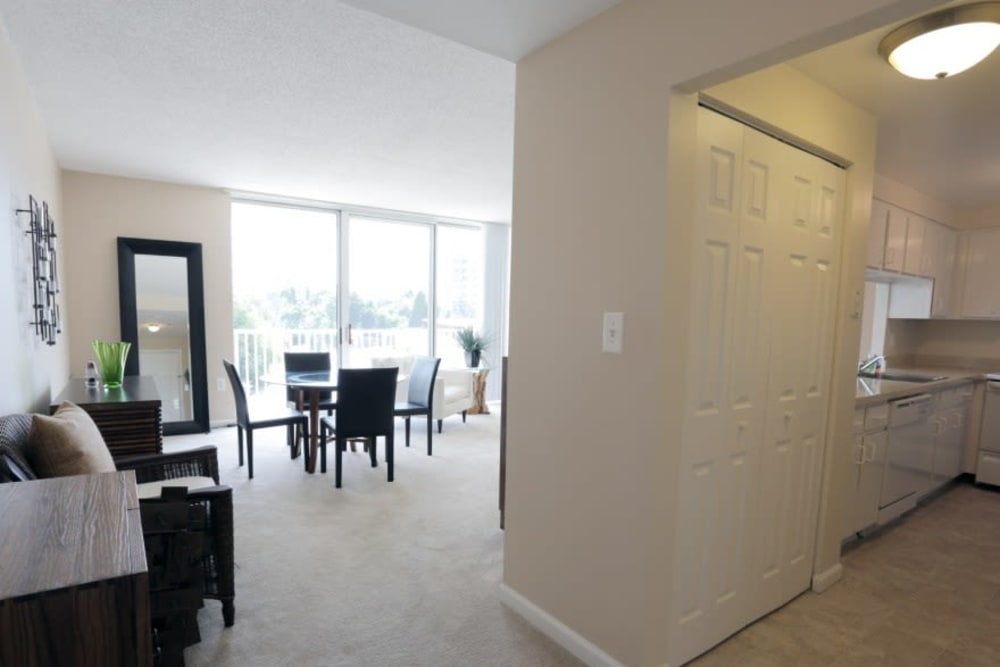 Spacious living room with a large sliding glass doors to the balcony at Westwood Tower Apartments in Bethesda, Maryland