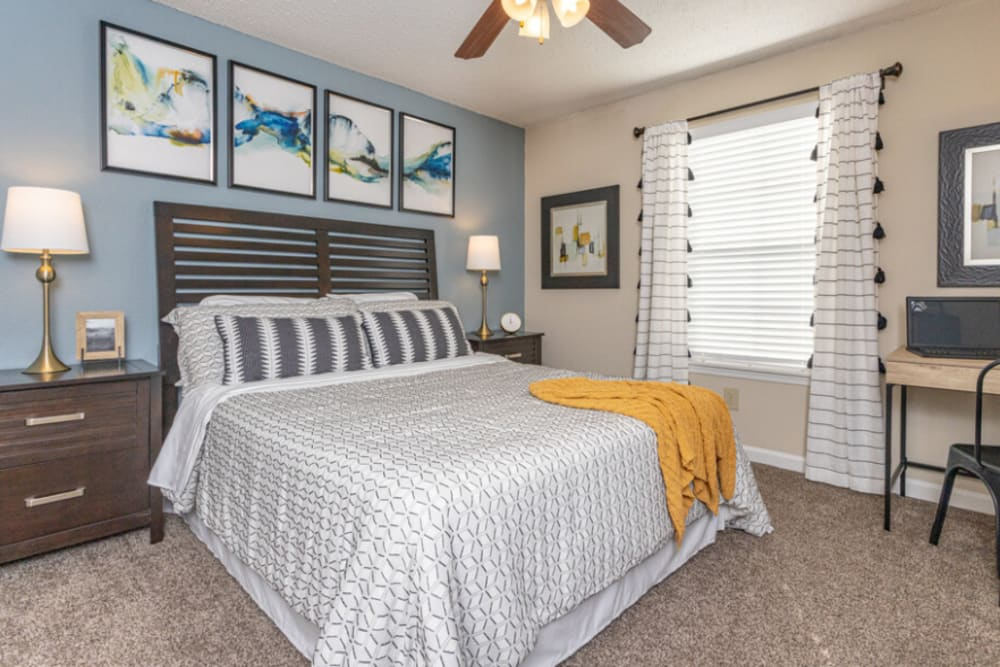 Cozy bedroom at The Abbey at Riverchase apartments in Hoover, AL