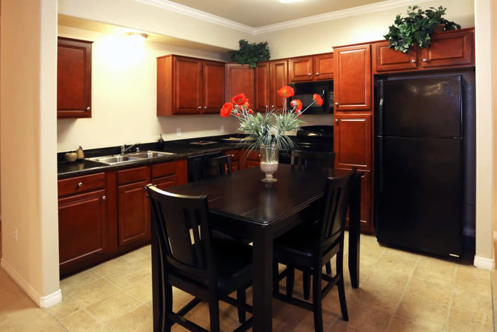 Dining room and kitchen at Wolf Ranch Condominium Rentals in Sacramento, California