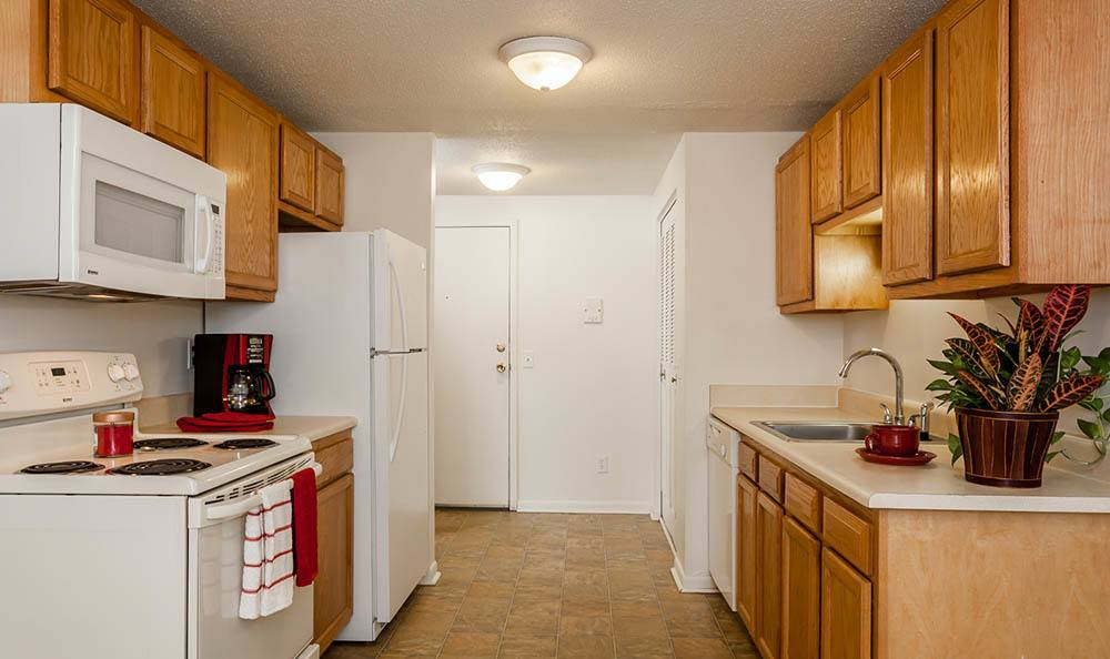 Well-equipped kitchen at King's Court Manor Apartments in Rochester, NY