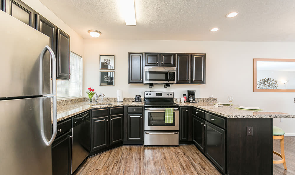 Well-equipped kitchen at Auburn Creek Apartments in Victor