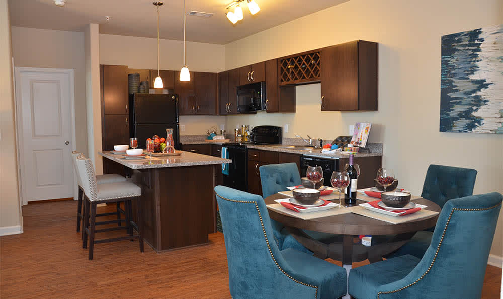 Dining Room And Kitchen At Springs at Alamo Ranch Apartments In San Antonio