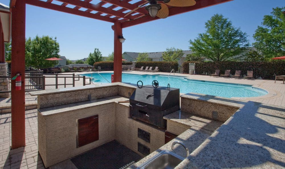 Clubhouse outdoor grill at Springs at Live Oak Apartments