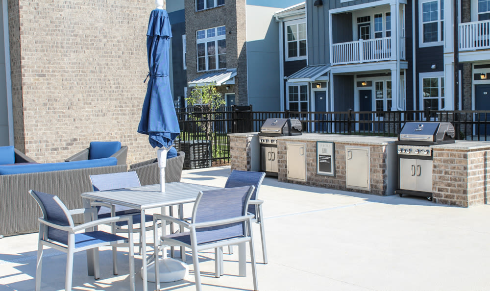 Outdoor kitchen and grill at Springs at West Chester Apartments in West Chester, OH