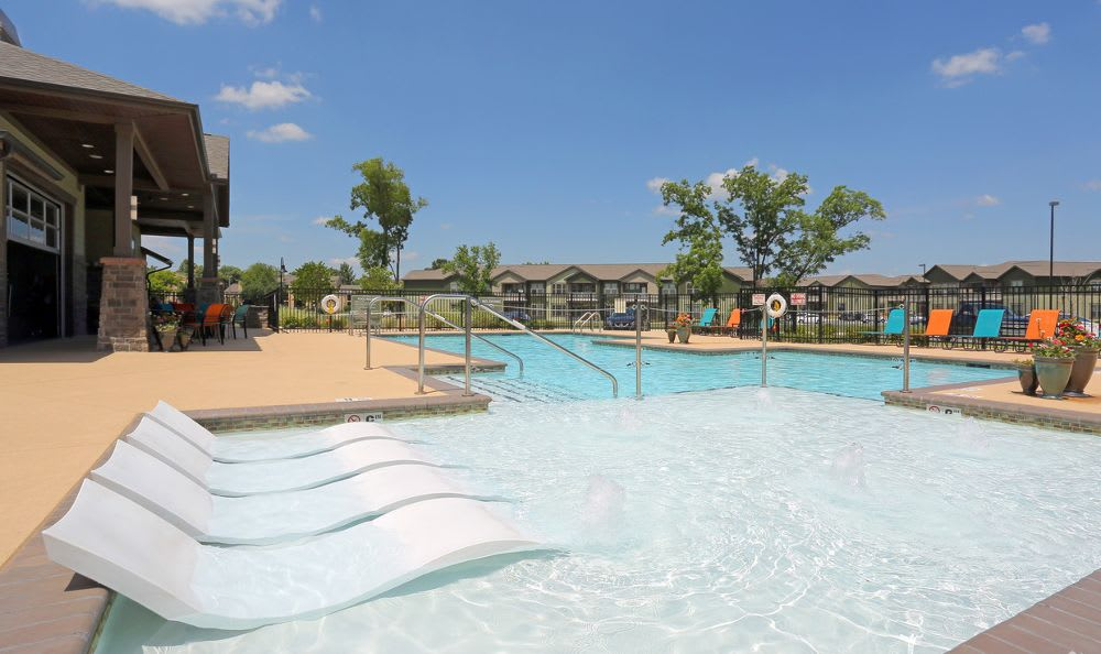 Resort Style Swimming Pool At Springs at Woodlands South Apartments In Tulsa