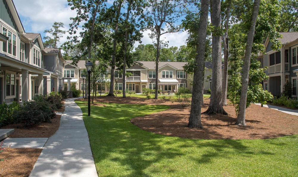 walking path through backyard at Springs at Essex Farms in Charleston, SC