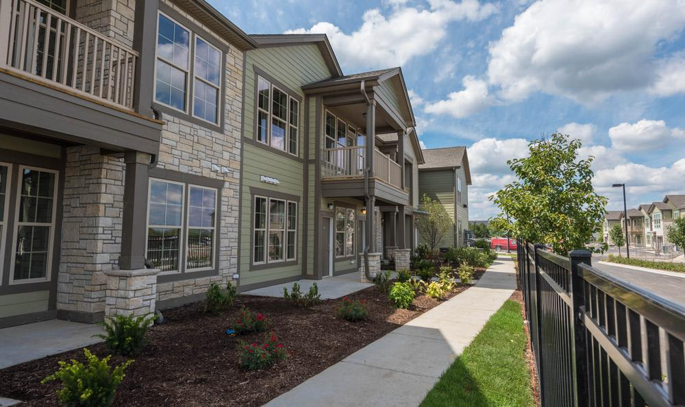 apartments walking path through yard at Springs at Weber Road in Romeoville, IL