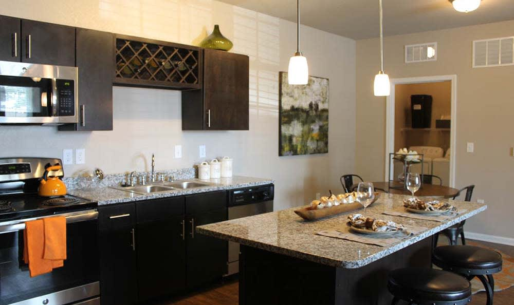 Kitchen with granite counter top at Springs at Cottonwood Creek Apartments