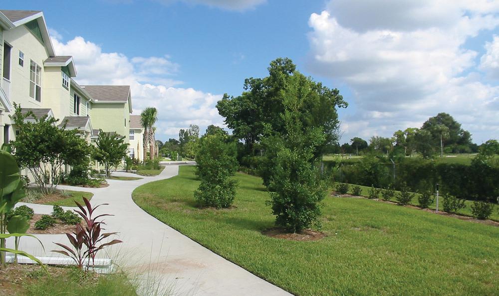 walking path through backyard at Springs at Palma Sola in Bradenton, FL
