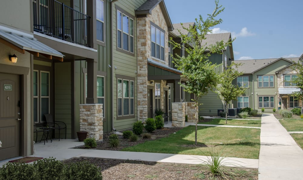 Apartments Front Yard at Springs at Creekside in New Braunfels, TX