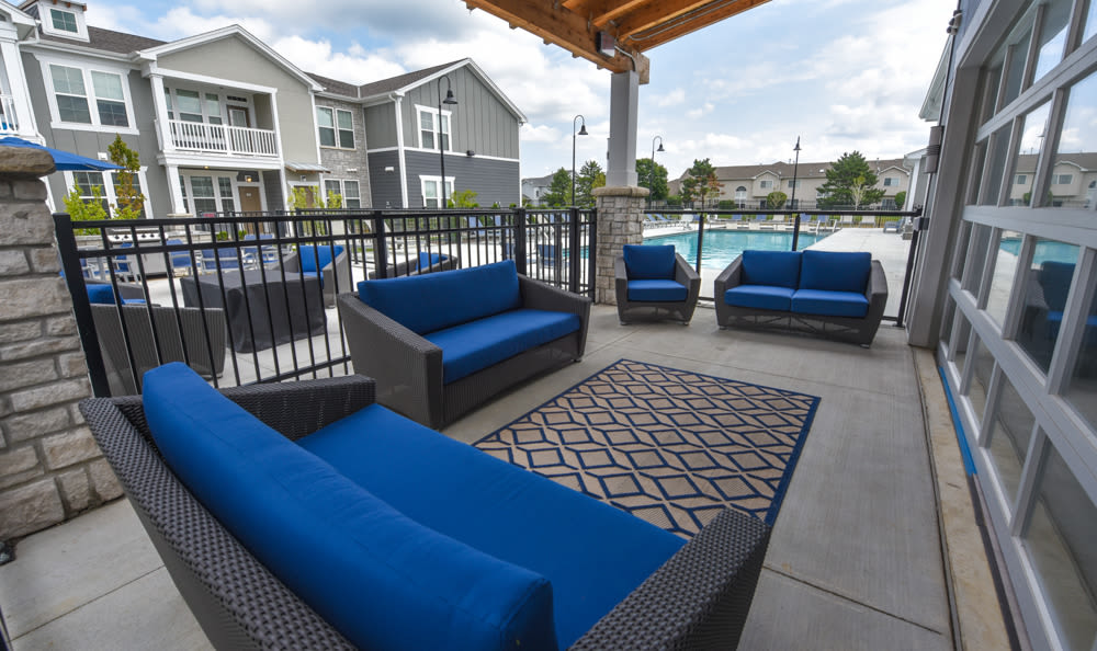 Lounge Area By the Pool at Springs at Lakeline Apartments