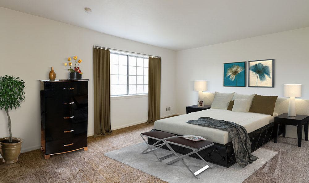 Cozy bedroom at Elmwood Terrace Apartments and Townhomes in Rochester, NY