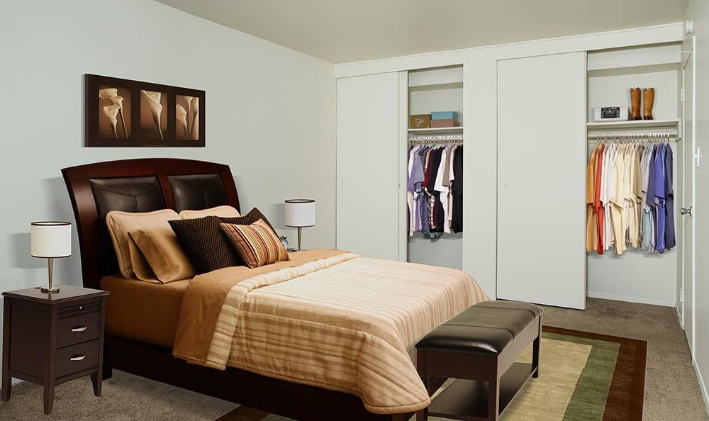 Comfy bed and closets at Hillcrest Village in Niskayuna, NY