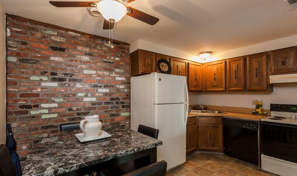 Kitchen and dining table at Raintree Island Apartments in Tonawanda, NY