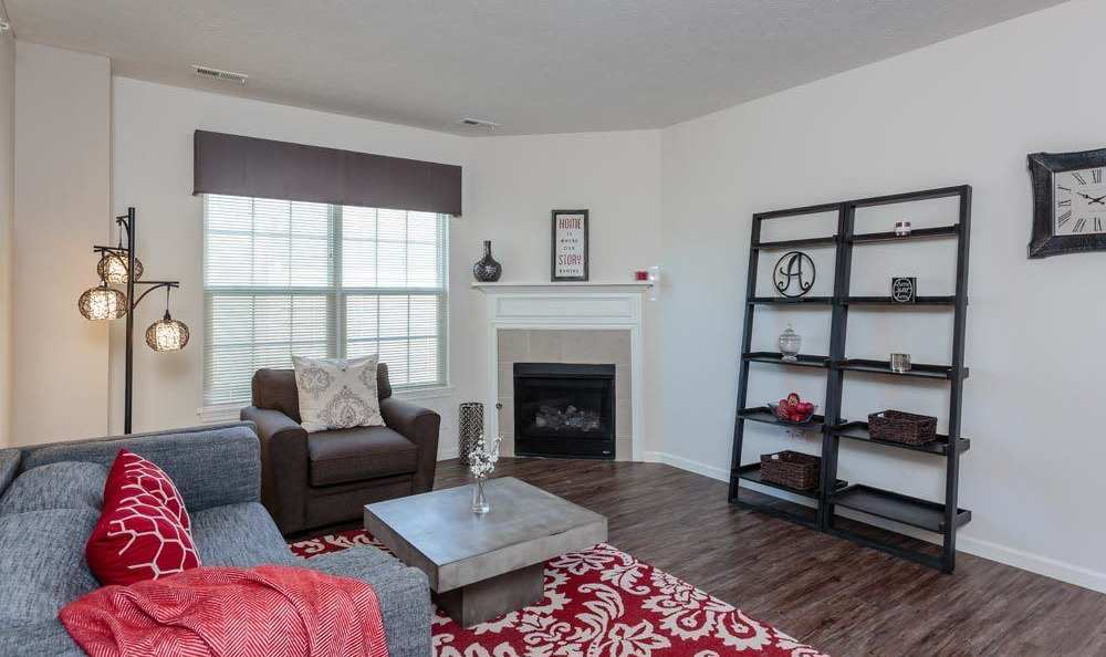 Spacious living room at Auburn Creek Apartments in Victor
