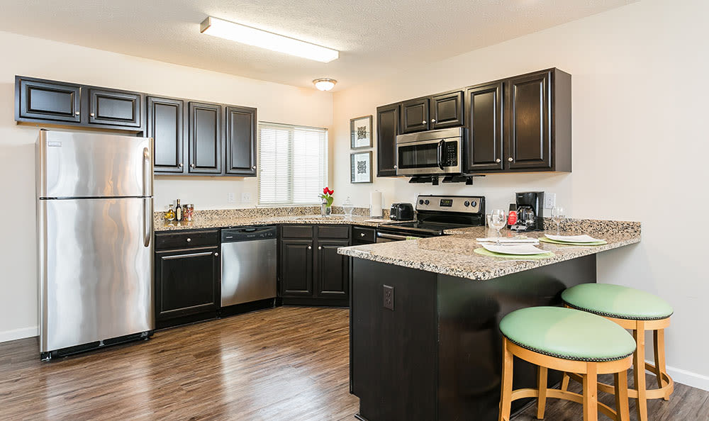 Enjoy our modern kitchen at Auburn Creek Apartments in Victor, Auburn Creek Apartments