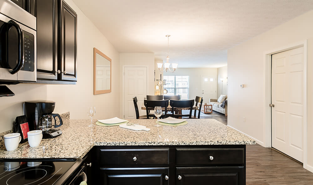 Kitchen and dining room at Auburn Creek Apartments in Victor