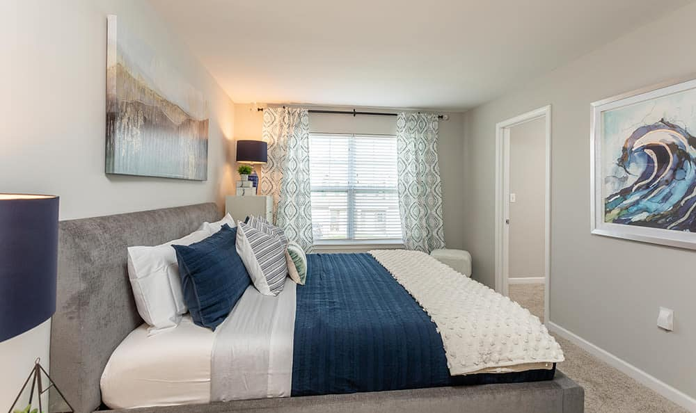 Spacious bedroom at Woodland Acres Townhomes in Liverpool, NY